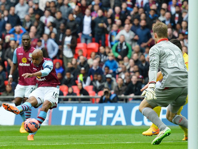 Aston Villa's English midfielder Fabian Delph shoots and scores past Liverpool's Belgian goalkeeper Simon Mignolet during the FA Cup semi-final between Aston Villa and Liverpool at Wembley stadium in London on April 19, 2015