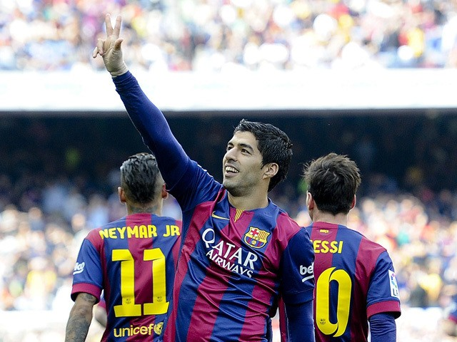 Barcelona's Uruguayan forward Luis Suarez celebrates his goal during the Spanish league football match FC Barcelona v Valencia CF at the Camp Nou stadium in Barcelona on April 18, 2015