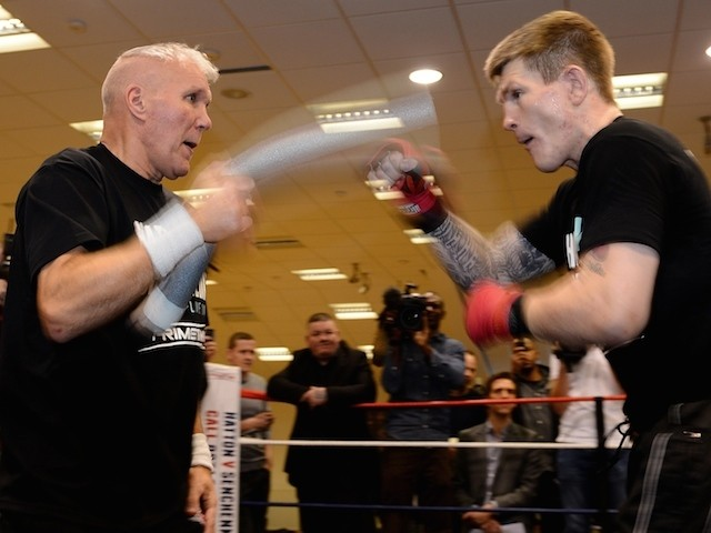 British boxer Ricky Hatton (R) trains with trainer Bob Shannon at the Hatton Health and Fitness gym in Hyde, Manchester, north-west England on November 14, 2012