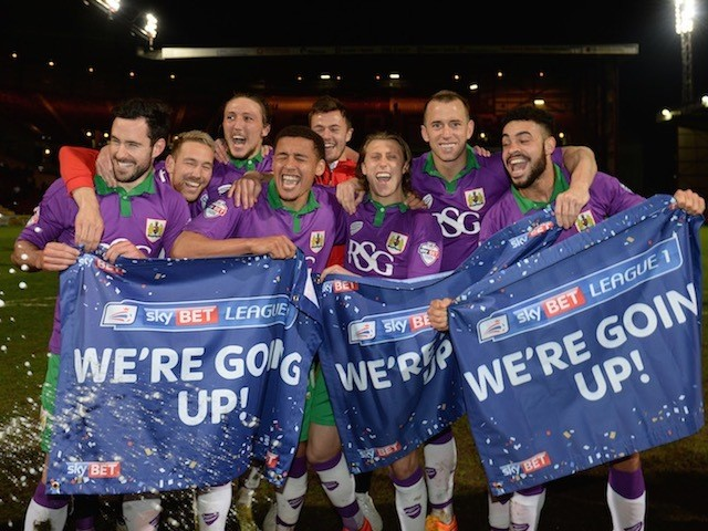 An assortment of Bristol City players celebrate their promotion to the Championship on April 14, 2015