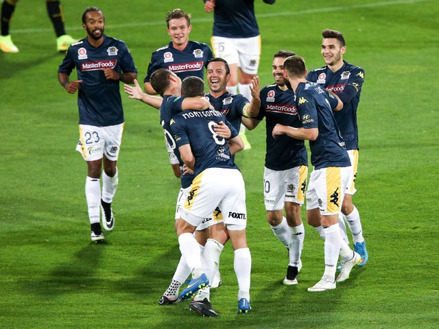 Eddy Bosnar of the Mariners is congratulated on his goal by teammates during the round 26 A-League match between the Wellington Phoenix and the Central Coast Mariners at Westpac Stadium on April 17, 2015