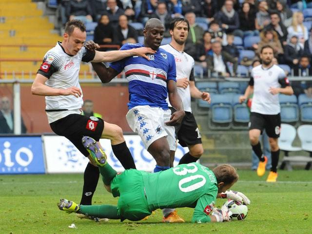 Goalkeeper of Cesena Federico Agliardi makes a save on Stefano Okaka of Sampdoria during the Serie A match between UC Sampdoria and AC Cesena at Stadio Luigi Ferraris on April 18, 2015