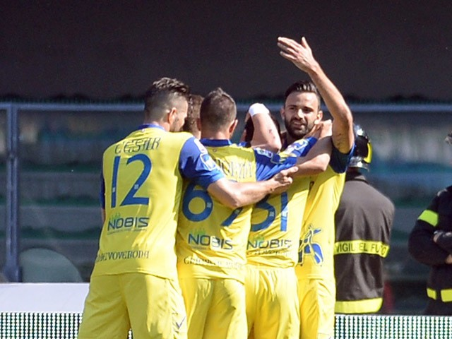 Sergio Pellissier of Chievo Verona is mobbed by team mates after scoring his opening goal during the Serie A match between AC Chievo Verona and Udinese Calcio at Stadio Marc'Antonio Bentegodi on April 19, 2015