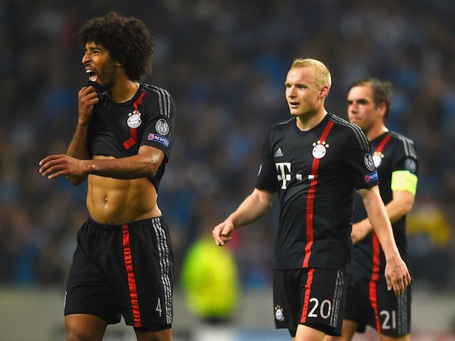 Dante, Sebastian Rode, Philipp Lahm and Robert Lewandowski of Bayern Muenchen look dejected in defeat after the during the UEFA Champions League Quarter Final first leg match between FC Porto and FC Bayern Muenchen at Estadio do Dragao on April 15, 2015