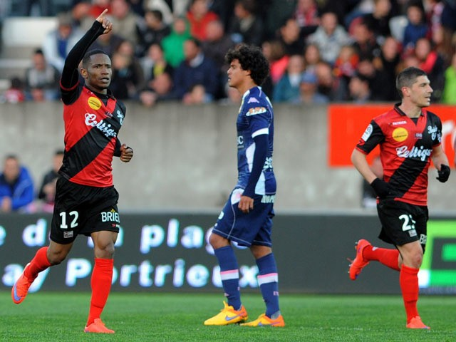 Guingamp's French midfielder Claudio Beauvue celebrates after scoring during the French L1 football match between Guingamp and Evian on April 18, 2015