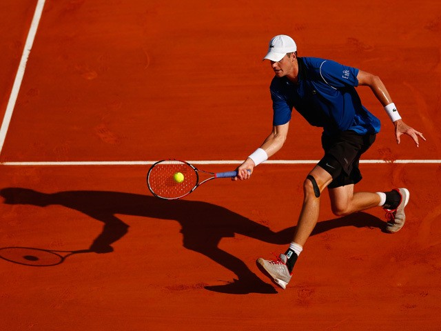 John Isner of USA plays a volley in his match against Steve Johnson of USA during day two of the Monte Carlo Rolex Masters tennis at the Monte-Carlo Sporting Club on April 13, 2015