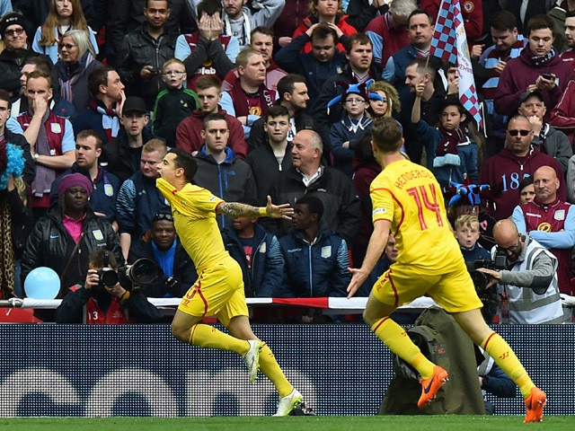 Liverpool's Brazilian midfielder Philippe Coutinho celebrates after scoring during the FA Cup semi-final between Aston Villa and Liverpool at Wembley stadium in London on April 19, 2015