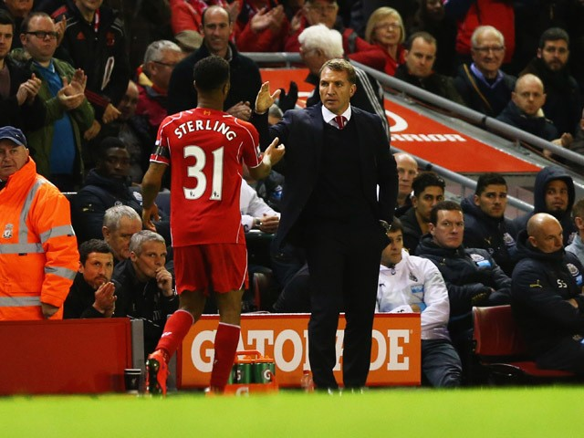 Brendan Rodgers manager of Liverpool shakes hands with Raheem Sterling of Liverpool as he is substituted during the Barclays Premier League match between Liverpool and Newcastle United at Anfield on April 13, 2015