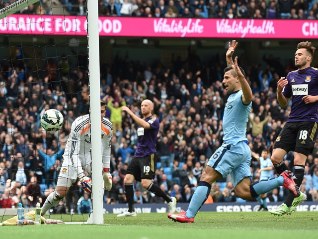 Manchester City's Argentinian striker Sergio Aguero follows up as the ball bounces into the goal after a big deflection off West Ham United's Welsh defender James Collins for a West Ham own goal to open the scoring during the English Premier League footba