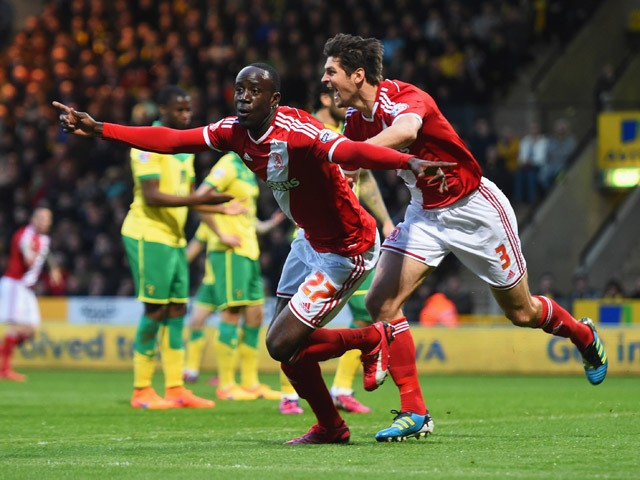 Albert Adomah and George Friend of Middlesbrough celebrate as Alexander Tettey of Norwich City scores their first goal with an own goal during the Sky Bet Championship match between Norwich City and Middlesbrough at Carrow Road on April 17, 2015