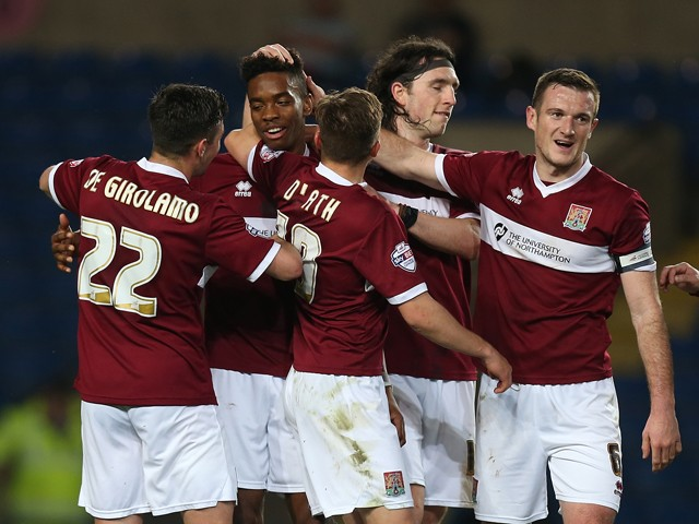 Ivan Toney of Northampton Town is congratulated by team mates after scoring his sides 1st goal during the Sky bet League Two match between Oxford United and Northampton Town at Kassam Stadium on April 14, 2015