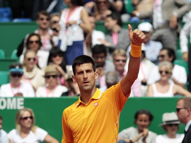 Serbian player Novak Djokovic celebrates after winning his Monte-Carlo ATP Masters Series Tournament tennis match against Croatian player Marin Cilic on April 17, 2015