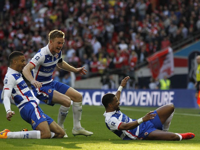 Reading's foward Jamaican forward Garath McCleary celebrates after scoring during the FA Cup semi-final between Arsenal and Reading at Wembley stadium in London on April 18, 2015