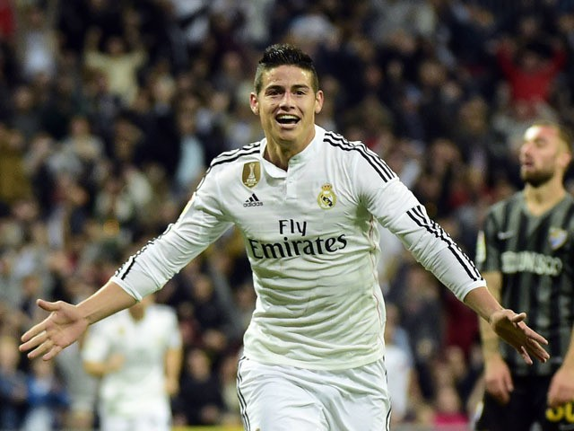 Real Madrid's Colombian midfielder James Rodriguez celebrates after scoring during the Spanish league football match Real Madrid CF vs Malaga FC at the Santiago Bernabeu stadium in Madrid on April 18, 2015