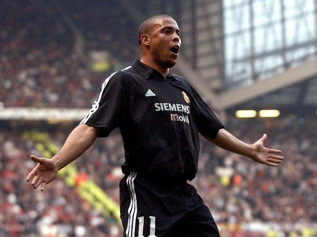 Real Madrid's Ronaldo celebrates after scoring against Manchester United during their UEFA Champions League quarter final 2nd leg at Old Trafford in Manchester 23 April 2003