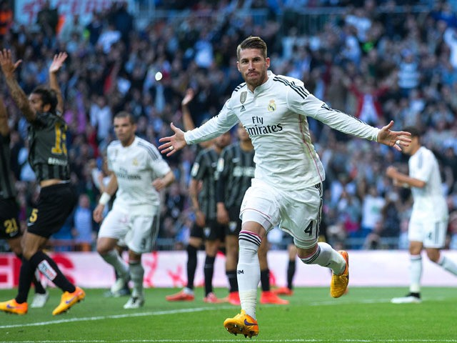Sergio Ramos of Real Madrid CF celebrates scoring their opening goal during the La Liga match between Real Madrid CF and Malaga CF at Estadio Santiago Bernabeu on April 18, 2015