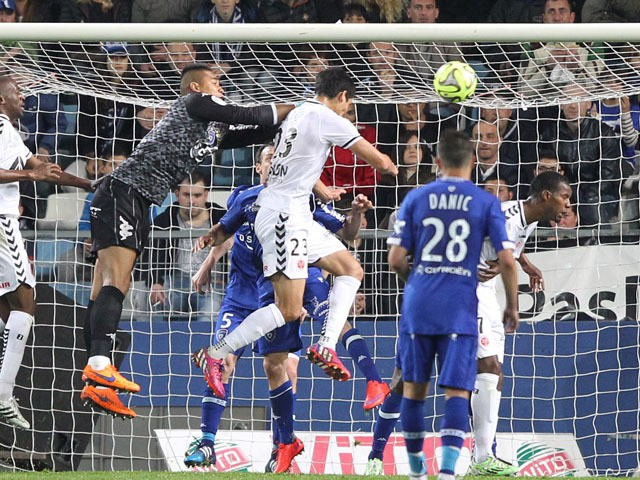 Reims' French Algerian defender Aissa Mandi scores a goal during the French L1 football match between Bastia (SCB) and Reims (SR) in the Armand Cesari stadium in Bastia, French Mediterranean island of Corsica, on April18, 2015
