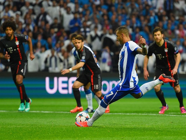 Ricardo Quaresma of FC Porto scores their first goal from the penalty spot during the UEFA Champions League Quarter Final first leg match between FC Porto and FC Bayern Muenchen at Estadio do Dragao on April 15, 2015
