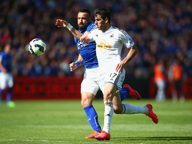 Nelson Oliveria of Swansea City and Marcin Wasilewski of Leicester City tussle for the ball during the Barclays Premier League match between Leicester City and Swansea City at The King Power Stadium on April 18, 2015