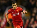 Philippe Coutinho runs with the ball for Liverpool during their Premier League meeting with Newcastle United on April 13, 2015