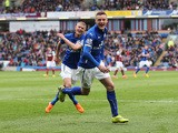Jamie Vardy of Leicester City celebrates scoring their first goal with Paul Konchesky of Leicester City during the Barclays Premier League match between Burnley and Leicester City at Turf Moor on April 25, 2015