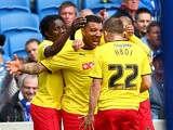 Troy Deeney of Watford is swamped by his teammates after scoring to make it 1-0 during the Sky Bet Championship match between Brighton & Hove Albion and Watford at Amex Stadium on April 25, 2015