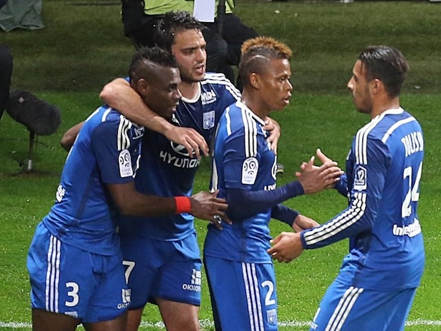 Lyon's forward Clinton Mua Njie (2nd L) celebrates with teammates after scoring a goal during the French Football match between Reims and Lyon on April 26, 2015