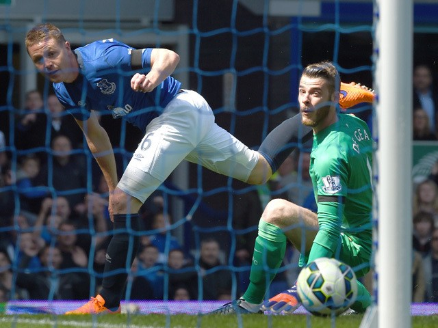 Everton's Scottish-born Irish midfielder James McCarthy scores past Manchester United's Spanish goalkeeper David de Gea during the English Premier League football match between Everton and Manchester United at Goodison park in Liverpool on April 26, 2015