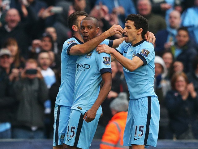 Fernandinho of Manchester City celebrates his winning goal with Martin Demichelis (L) and Jesus Navas of Manchester City during the Barclays Premier League match between Manchester City and Aston Villa at Etihad Stadium on April 25, 2015