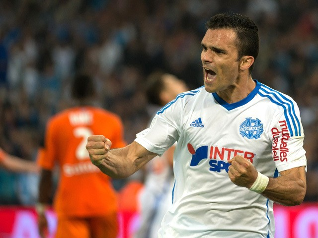 Marseille's French defender Jeremy Morel celebrates after scoring a goal during the French L1 football match between Marseille and Lorient on April 24, 2015