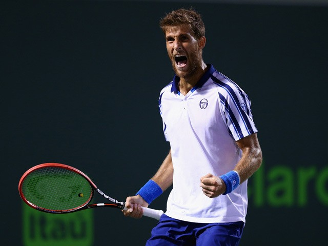 Martin Klizan of Slovakia celebrates a point against Novak Djokovic of Serbiain their second round match during the Miami Open Presented by Itau at Crandon Park Tennis Center on March 28, 2015