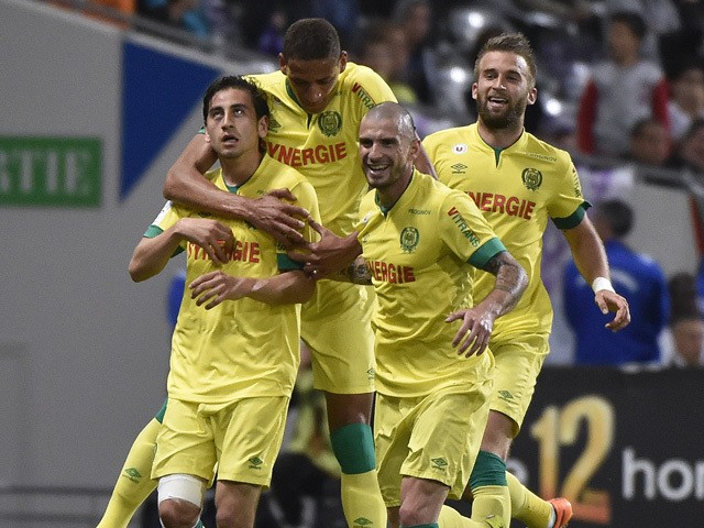 Nantes' US midfielder Alejandro Bedoya celebrates with teammates after scoring a goal during the French L1 football match between Toulouse and Nantes at the Municipal Stadium in Toulouse on April 25, 2015