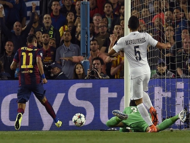 Barcelona's Brazilian forward Neymar da Silva Santos Junior (L) scores a goal during the UEFA Champions League quarter-finals second leg football match FC Barcelona vs Paris Saint-Germain at the Camp Nou stadium in Barcelona on April 21, 2015