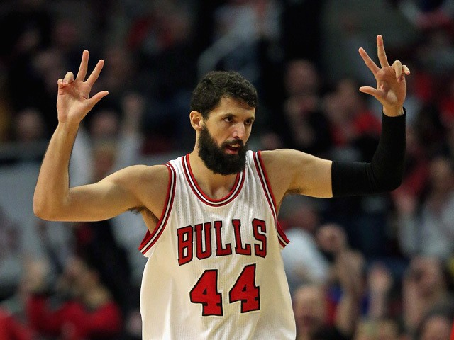 Nikola Mirotic #44 of the Chicago Bulls holds up his fingers after hitting a three point shot against the Toronto Raptors at the United Center on March 20, 2015