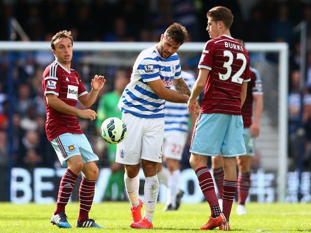 Charlie Austin of QPR throws the ball down in frustration during the Barclays Premier League match between Queens Park Rangers and West Ham United at Loftus Road on April 25, 2015
