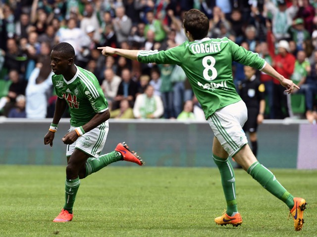 Saint-Etienne's Ivorian forward Max-Alain Gradel is congratuled by his teammate St Etienne's French midfielder Benjamin Corgnet after he scored during the French L1 football match AS Saint-Etienne against Montpellier HSC, on April 26, 2015