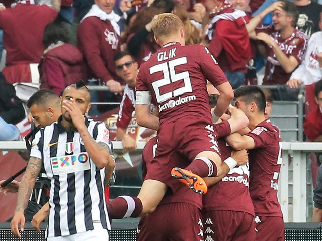 Torino's forward Fabio Quagliarella celebrates with his teammates after scoring during the Italian Serie A football match Torino vs Juventus on April 26, 2015