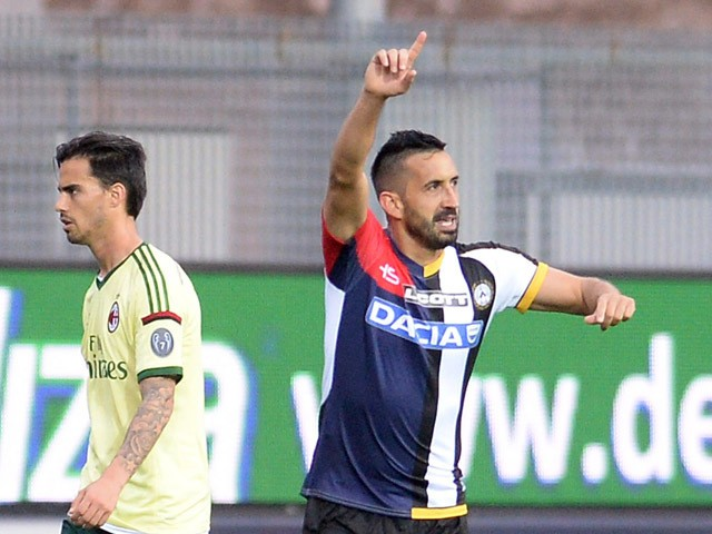 Giampiero Pinzi of Udinese Calcio celebrates after scoring his opening goal during the Serie A match between Udinese Calcio and AC Milan at Stadio Friuli on April 25, 2015
