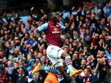 Christian Benteke of Aston Villa celebrates scoring his te