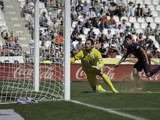 Luis Suarez of FC Barcelona scores their fourth goal past goalkeeper Juan Carlos Martin of Cordoba CF during the La Liga match between Cordoba CF and Barcelona FC at El Arcangel stadium on May 2, 2015