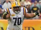 Tackle Lael Collins #70 of the LSU Tigers sets for play against the Iowa Hawkeyes January 1, 2014