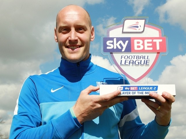 Southend United defender Adam Barrett with his Player of the Month award for April on April 30, 2015