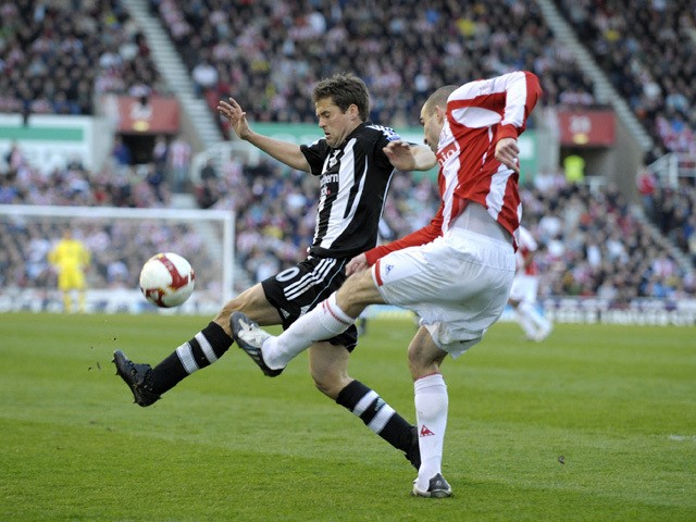 Newcastle''s English striker Michael Owen (L) vies with Stoke's English defender Danny Higgingbotham during the English Premier League football match between Stoke City and Newcastle United at the Britannia Stadium, Stoke-on-Trent, north-west England, on