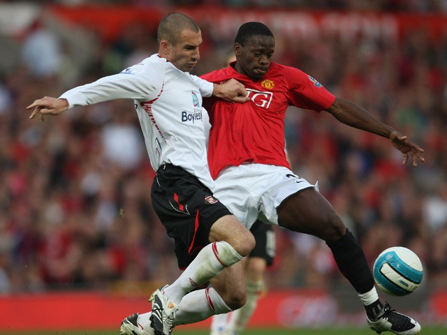 Louis Saha of Manchester United battles for the ball with Danny Higginbotham of Sunderland during the Barclays Premier League match between Manchester United and Sunderland at Old Trafford on September 1, 2007