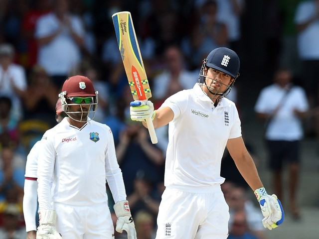 England's cricket team captain Alastair Cook reacts after scoring his half-century (50 runs) during the first day of the final match of a three-match Test series between England and West Indies at the Kensington Oval Stadium in Bridgetown on May 1, 2015