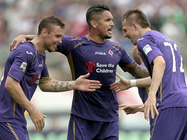 Josip Ilicic (R) of ACF Fiorentina celebrates after scoring a goal during the Serie A match between ACF Fiorentina and AC Cesena at Stadio Artemio Franchi on May 3, 2015
