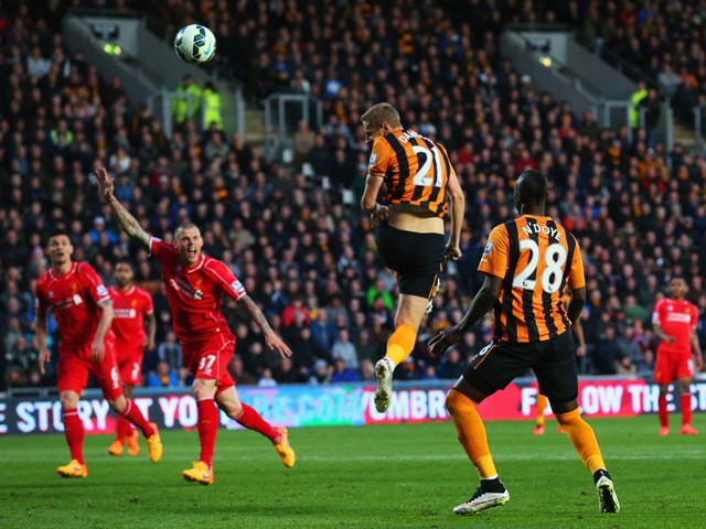 Michael Dawson of Hull City scores their first goal during the Barclays Premier League match between Hull City and Liverpool at KC Stadium on April 28, 2015