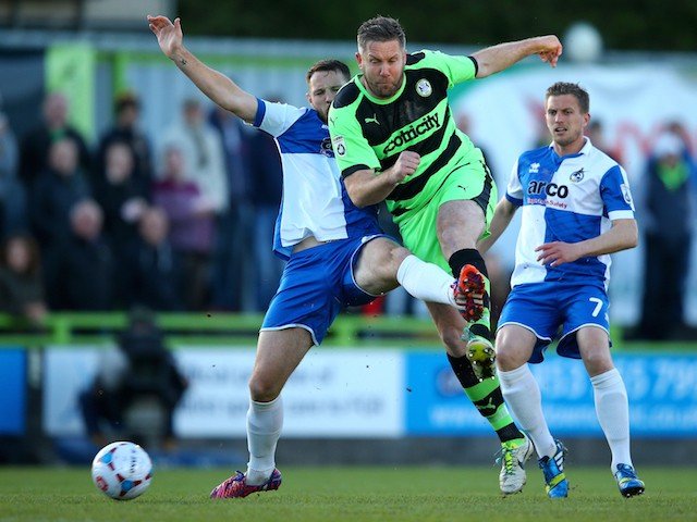 Jonathan Parkin of Forest Green is tackled by Tom Parkes of Bristol Rovers during the first leg of the Vanarama Football Conference playoff semi-final between Forest Green Rovers and Bristol Rovers at The New Lawn Stadium on April 29, 2015