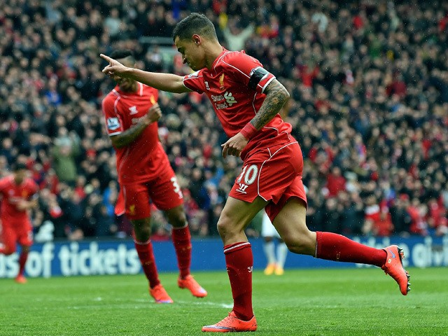 Liverpool's Brazilian midfielder Philippe Coutinho celebrates scoring during the English Premier League football match between Liverpool and Queens Park Rangers at the Anfield stadium in Liverpool, northwest England, on May 2, 2015