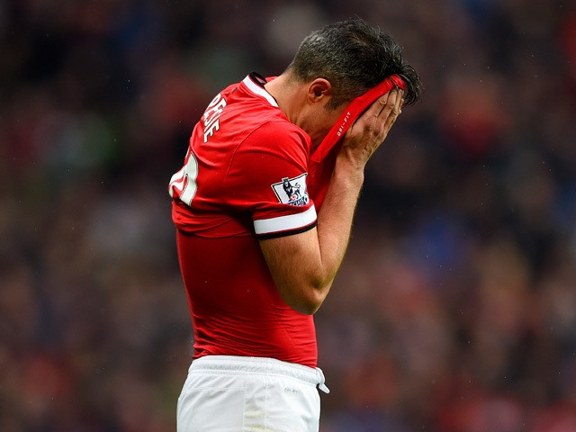 Robin van Persie of Manchester United reacts after missing a penalty during the Barclays Premier League match between Manchester United and West Bromwich Albion at Old Trafford on May 2, 2015